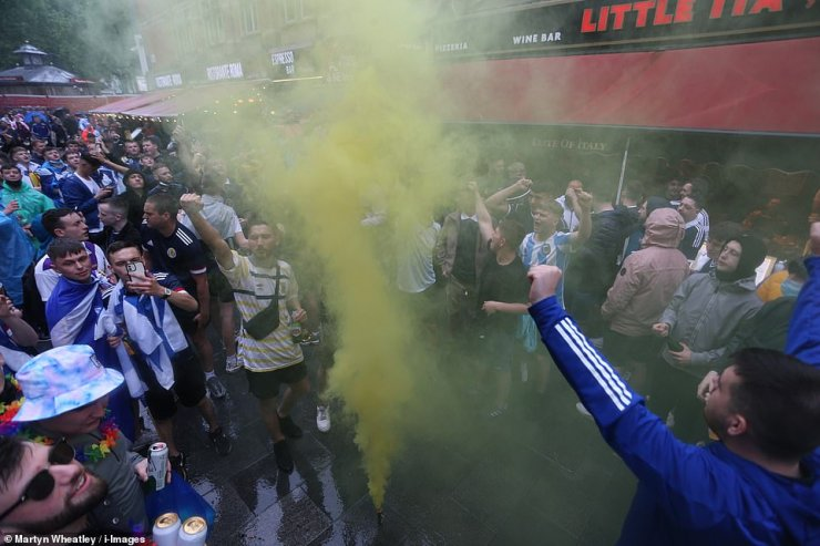 Showing plenty of flare:Scottish football fans arrive in London today for the European Championship tie versus England