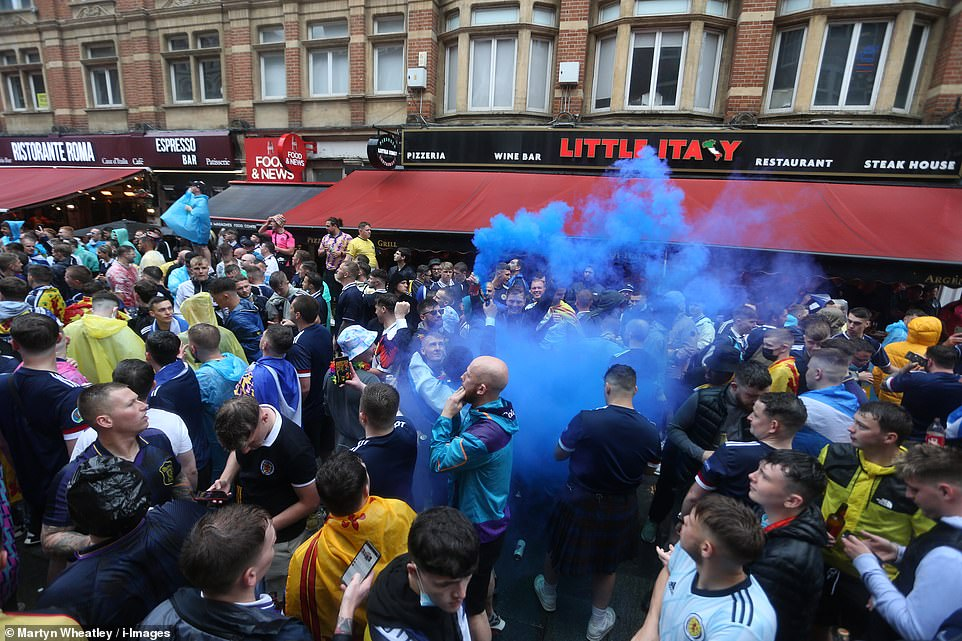 Flaring up!Scottish football fans arrive in London today for the European Championship tie versus England this afternoon