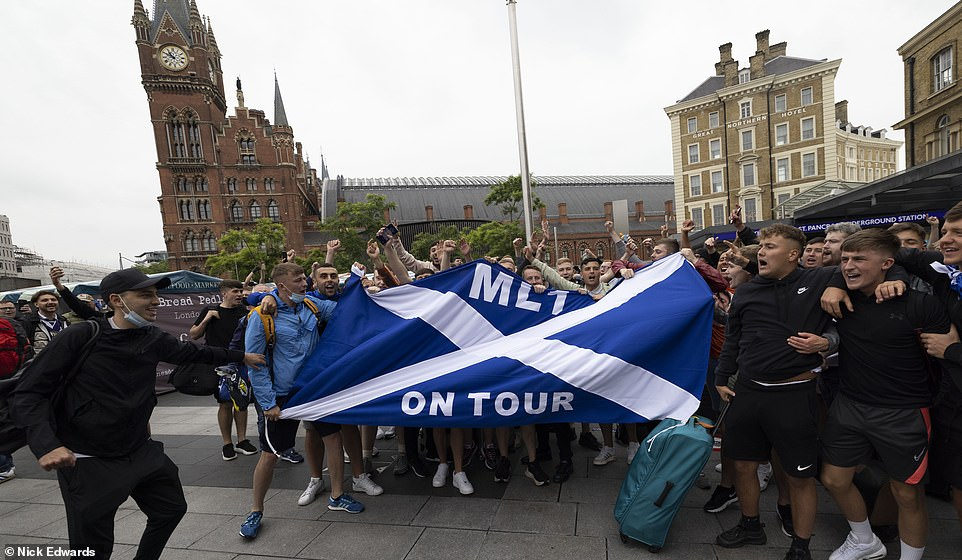 There are also concerns about Scotland fans infiltrating the home areas of the stadium as tickets are still changing hands on various resale websites. Pictured: Scotland fans in London yesterday