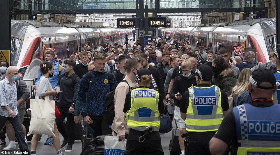 Vast swathes of fans - several not wearing masks - were seen flooding off trains as they arrived in the capital yesterday
