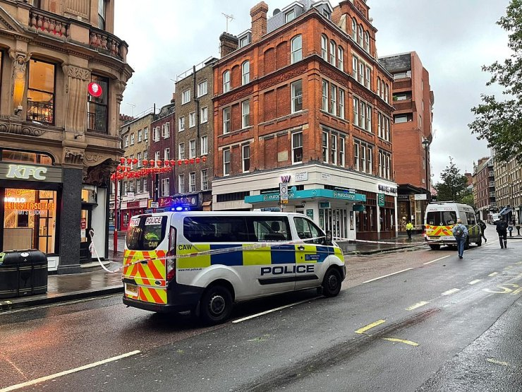 Two men were badly hurt after a fight on the road just behind Leicester Square as Scottish fans partied (crime scene pictured). The Met says a 55-year-old male is fighting for his life, and police say inquiries are going including into whether it is football related.