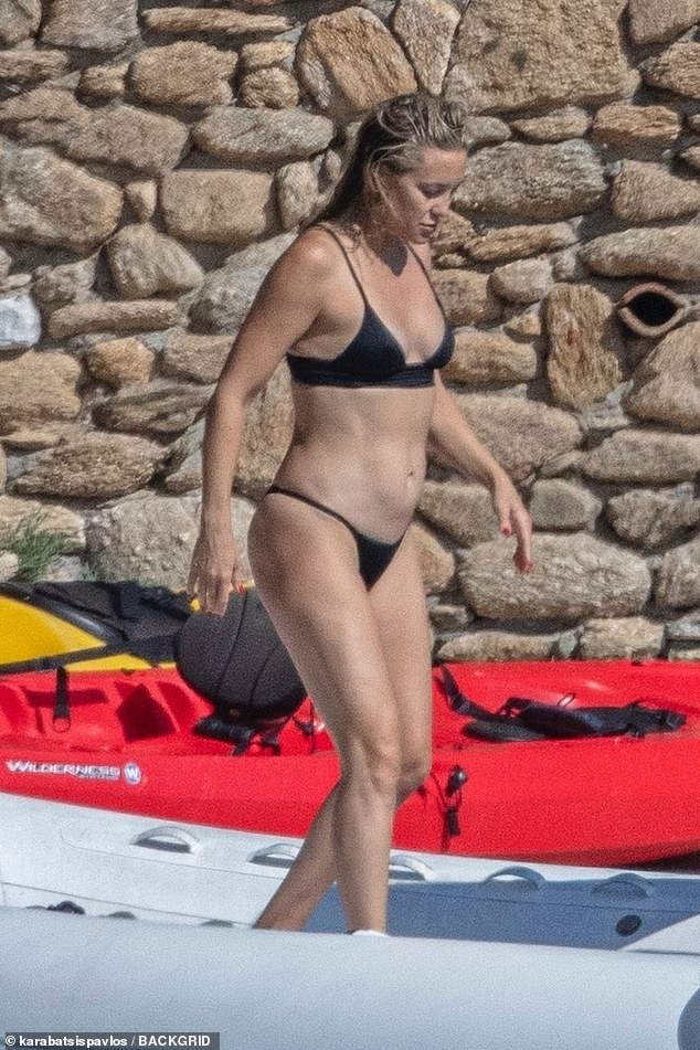 Abs fab: Kate Hudson wore a plunging black bikini on Friday as she was pictured in Skiathos, Greece with her family