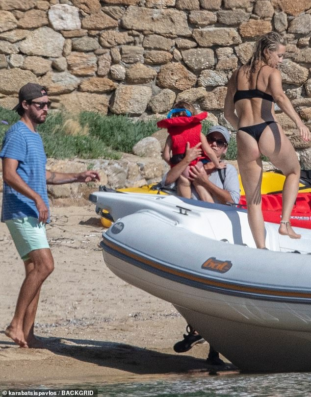 The Bride Wars star was seen with boyfriend Danny Fujikawa and their two-year-old daughter Rani as they moored the boat ashore in Skiathos