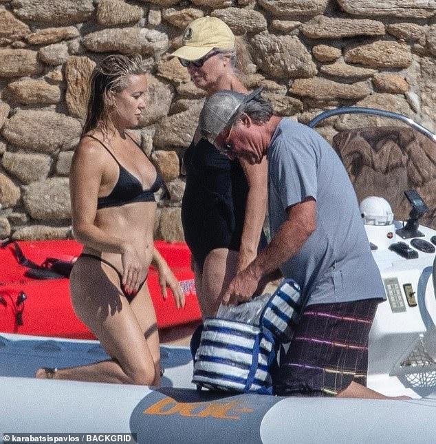 Beach day: 70-year-old stepdad Kurt was seen helping pack things