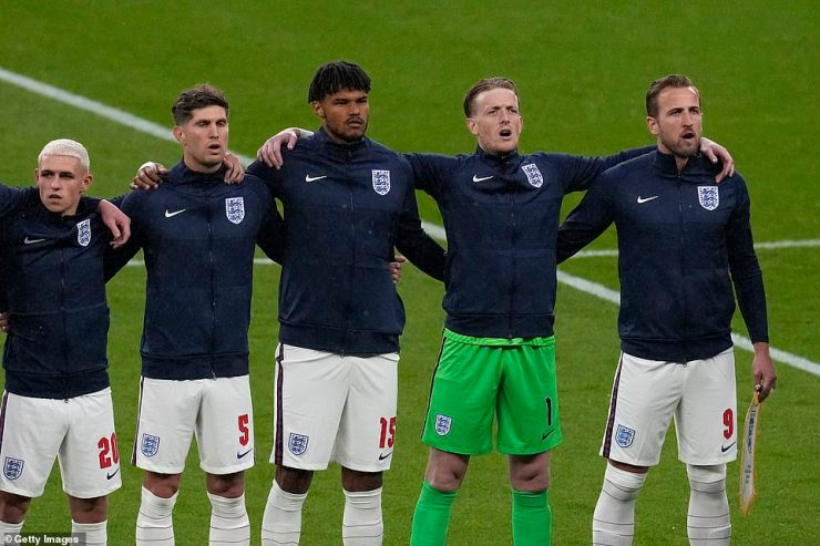 Phil Foden, John Stones, Tyrone Mings, Jordan Pickford and Harry Kane of England stand for the national anthem prior to the match