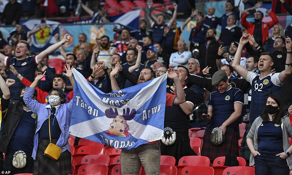 Scotland supporters hold up their banners as they cheer and sing their way through the opening moments of the game on Friday