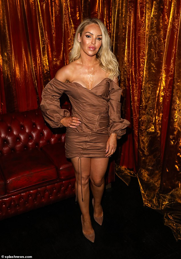 Glamourpuss:Katie Piper looked sensational on Friday in a bardot mini dress as she made her grand entrance at Cabaret All Stars at Proud Embankment with a friend