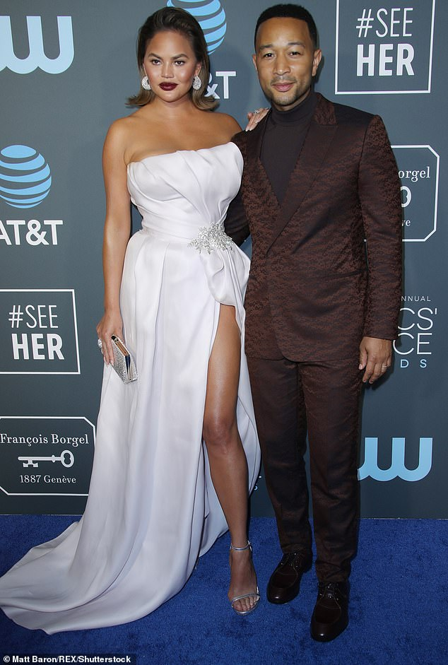 Chrissy Teigen goes on the attack: Model and husband John Legend SLAM Project Runway star's bullying claims - as she's accused of pushing singer at the Grammys (Pictured, 2019)