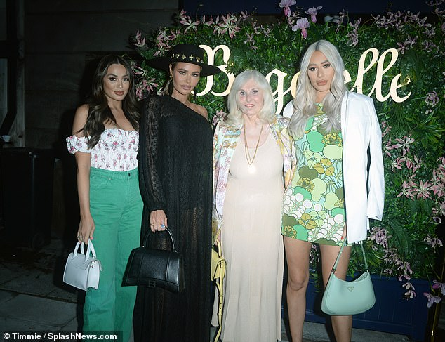 Celebrate: The birthday girl Linda looked radiant in a nude coloured midi dress and yellow heeled sandals as she smiled while surrounded by her granddaughters