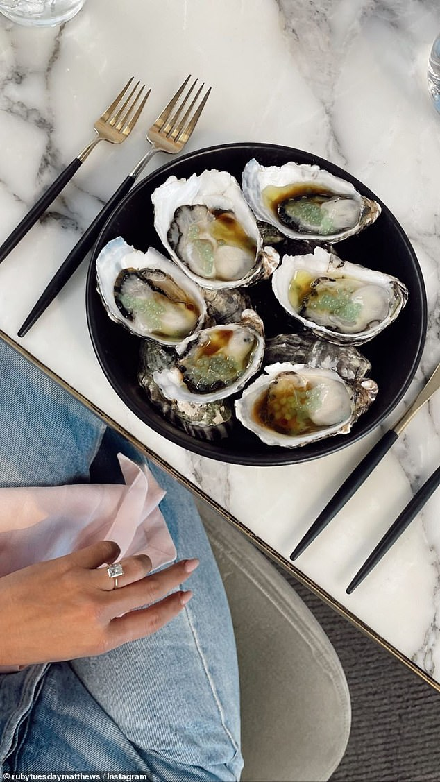 Wow: Meanwhile on her Instagram Story, she shared a post showing a plate of oysters and another angle of her ring. The beautiful baguette cut diamond appeared set on a slender and elegant silver band