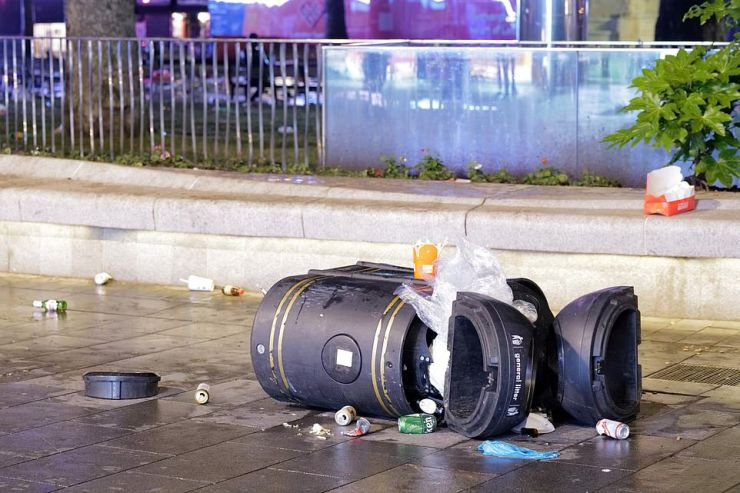 A bin was tipped over amid the raucous celebrations last night, with rubbish also left strewn across pavements