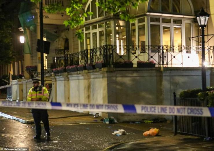 One man - believed to be a Scotland supporter - had to be rushed to hospital after he fell from a sixth-floor window of a hotel in Lancaster Gate last night. His condition is not believed to be life-threatening, Met Police (pictured at the scene last night) confirmed