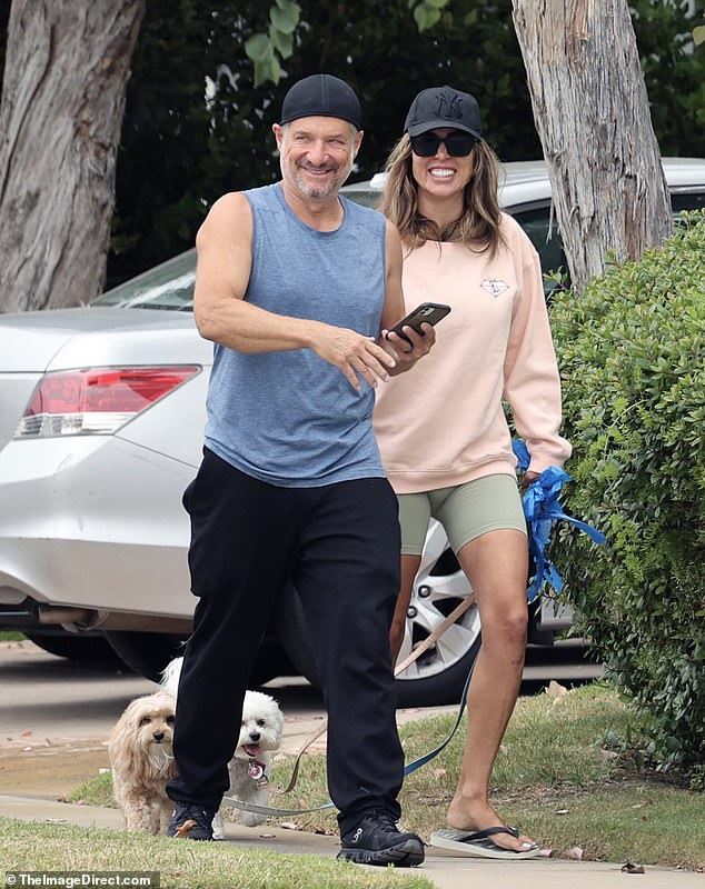 Smiling pair: Kelly Dodd looked unfazed and indifferent on Saturday, when she was seen dating her husband Rick Leventhal in Newport Beach in what amounted to her first public observation since being cut from The Real Housewives of Orange County
