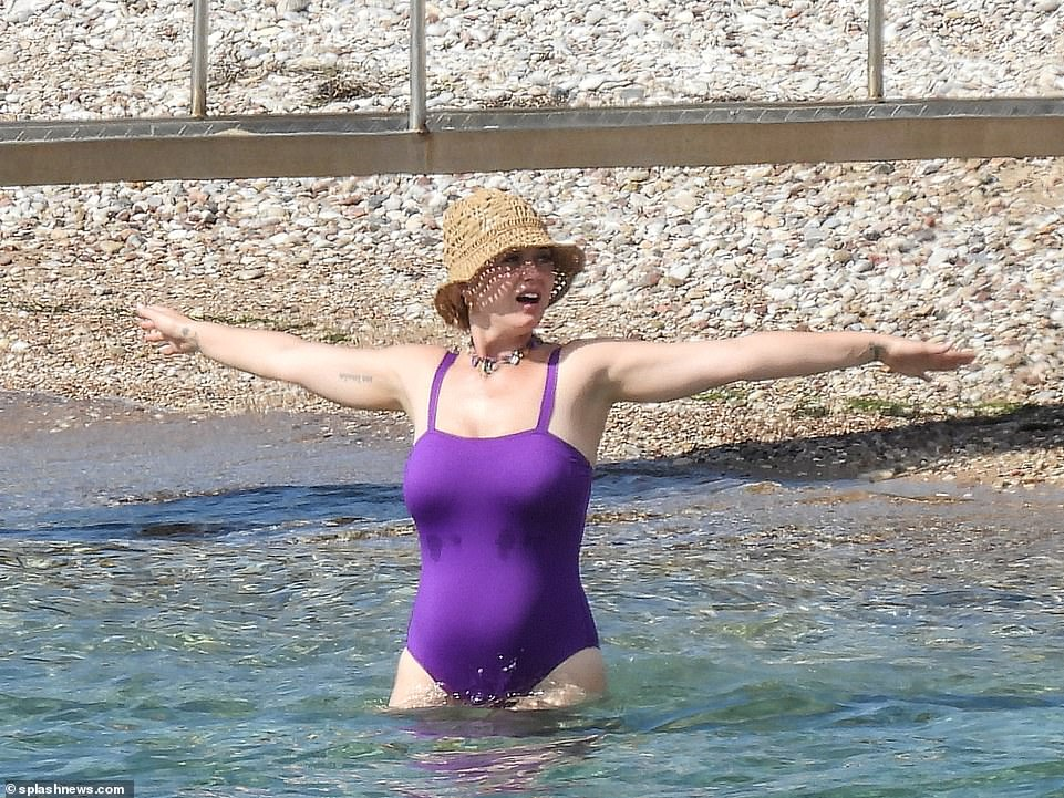 You go girl: Katy seemed to be having the best time as she threw herself into the sea