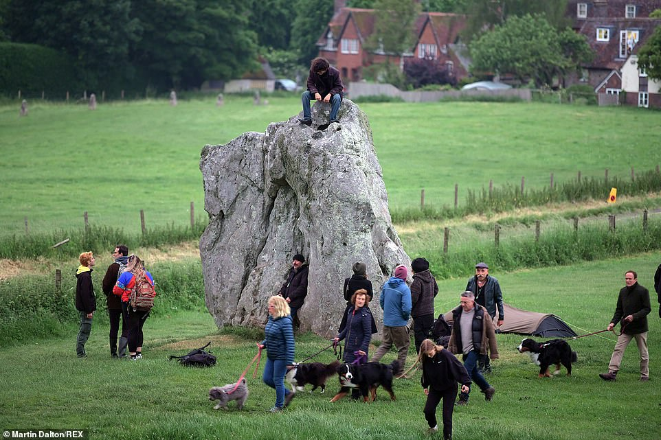 Hundreds of revellers see in the dawn on the longest day of the year at Avebury Stone Circle