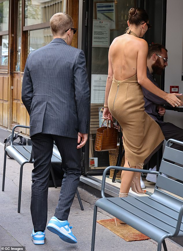 Back:The model, 24, displayed red cupping bruises in a beautiful backless dress that featured wraparound detailing