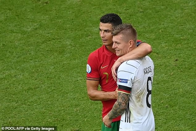 Footballers still hug each other, bump heads in affection or anger and protest referees in herds