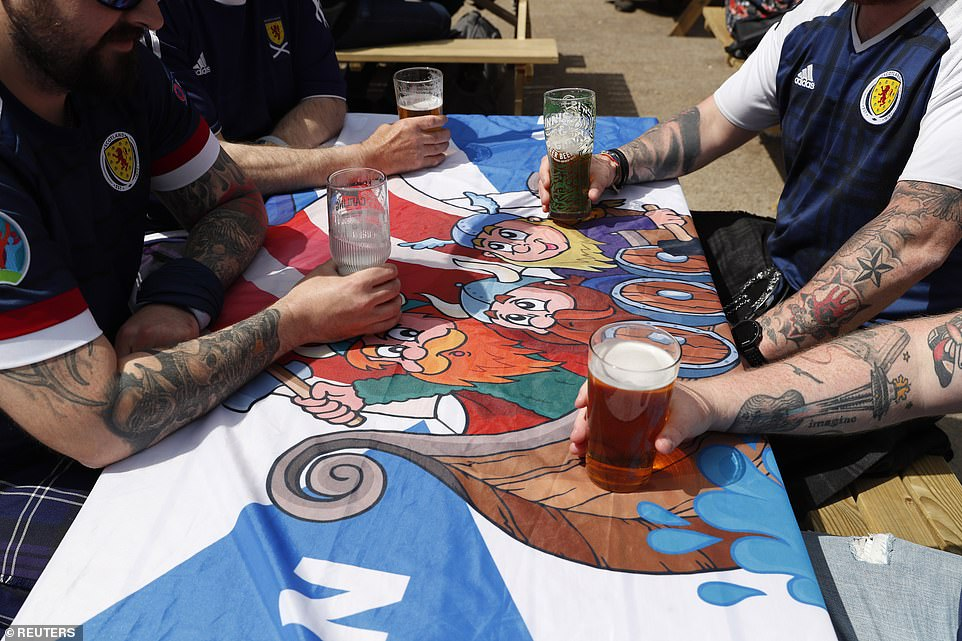 Scotland fans enjoy a pint in Glasgow today ahead of the match tonight to decide if they get through to the next round