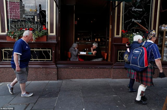Scotland fans are seen in Glasgow ahead of the match tonight which will decide qualification for the next round