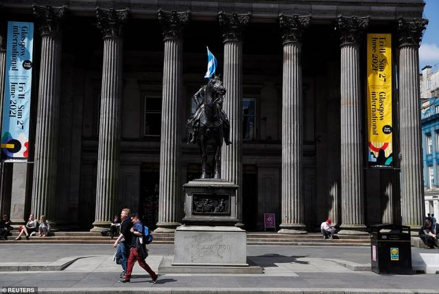 The Scottish flag on the equestrian statue of Arthur Wellesley, the 1st Duke of Wellington, outside the Gallery of Modern Art