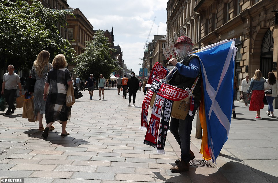 A merchandise seller is seen in Glasgow ahead of the match this evening which will see Scotland take on Croatia