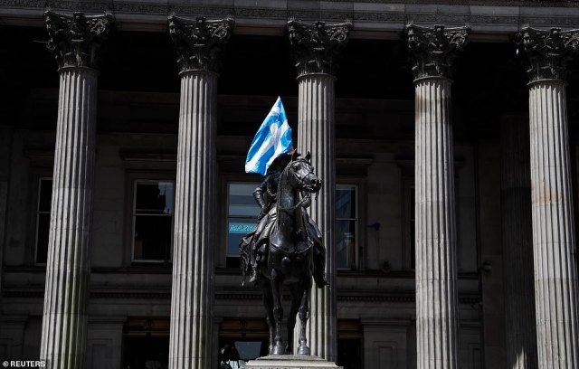The Scottish flag is seen on the equestrian statue of Arthur Wellesley, the 1st Duke of Wellington, in Glasgow this afternoon
