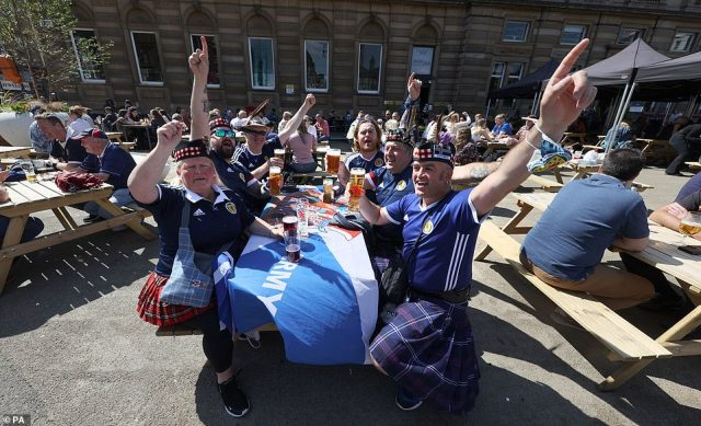 The celebrations began early in St George's Square in Glasgow as fans rocked tartan kilts and draped tables in the Scottish flag