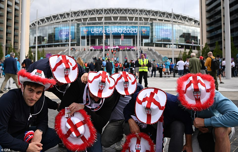 Fans dressed in colourful England cowboy hats were pictured outside Wembley Stadium this afternoon, hours before kick-off