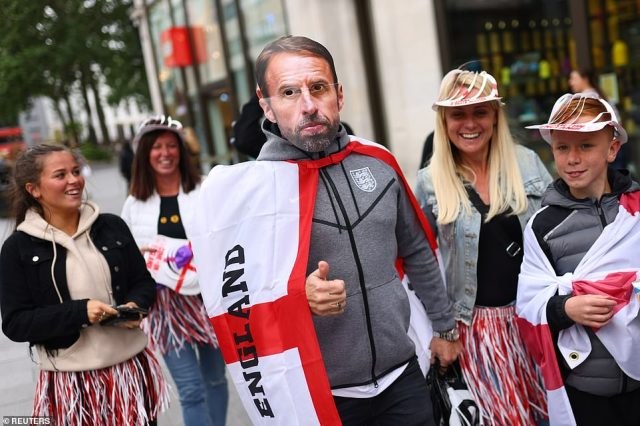 Is that you Gareth? England fans, including one wearing a Gareth Southgate mask, soaked up the atmosphere in London tonight ahead of the game against Croatia