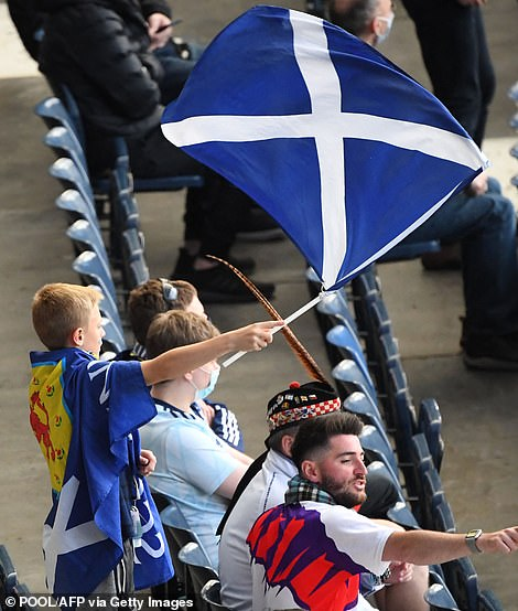 Fans were seen waving Scotland flags ahead of the game at Hampden Park
