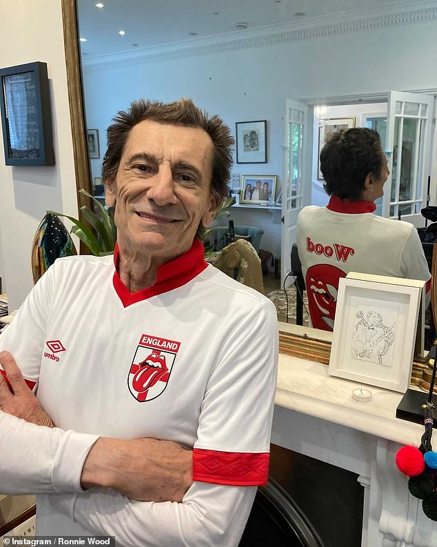 Getting in the mood! Victoria wasn't the only star getting ready for another night of sporting action, as Rolling Stones' Ronnie Wood shared a pair of snaps in a specially-made England shirt