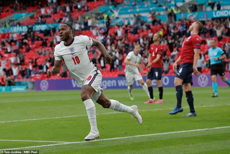 Raheem Sterling wheels away in celebration after heading England into the lead against Czech Republic at Wembley