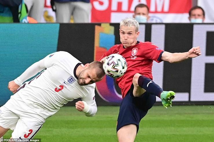 Luke Shaw bravely heads the ball away asCzech Republic's midfielder Jakub Jankto (right) looks to strike the ball
