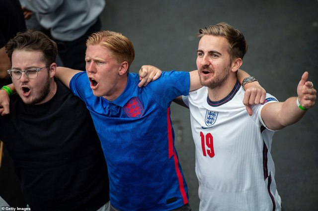 England fans link arms and sing as England go 1-0 up in their game against Czech Republic at Wembley, with tonight's winner going top of the group