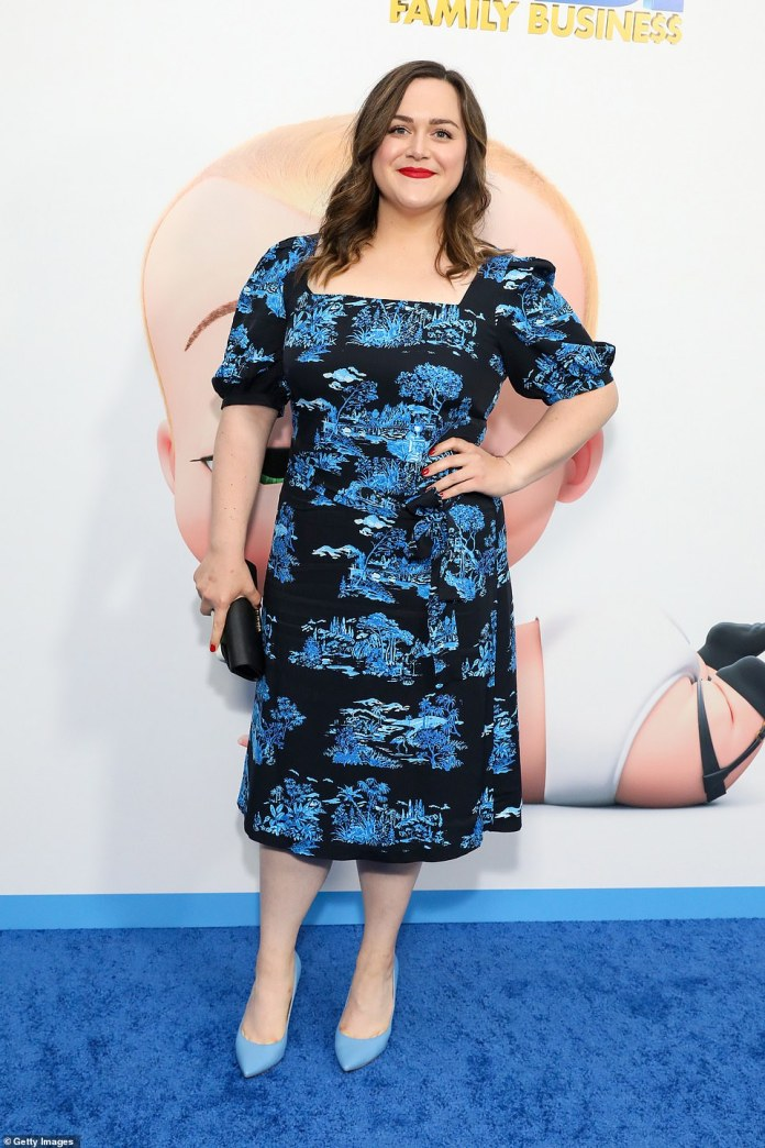 Beauty in blue:Producer Dina De Luca coordinated with the Boss Baby blue theme by wowing in a fitted number complete with powder blue stiletto heels