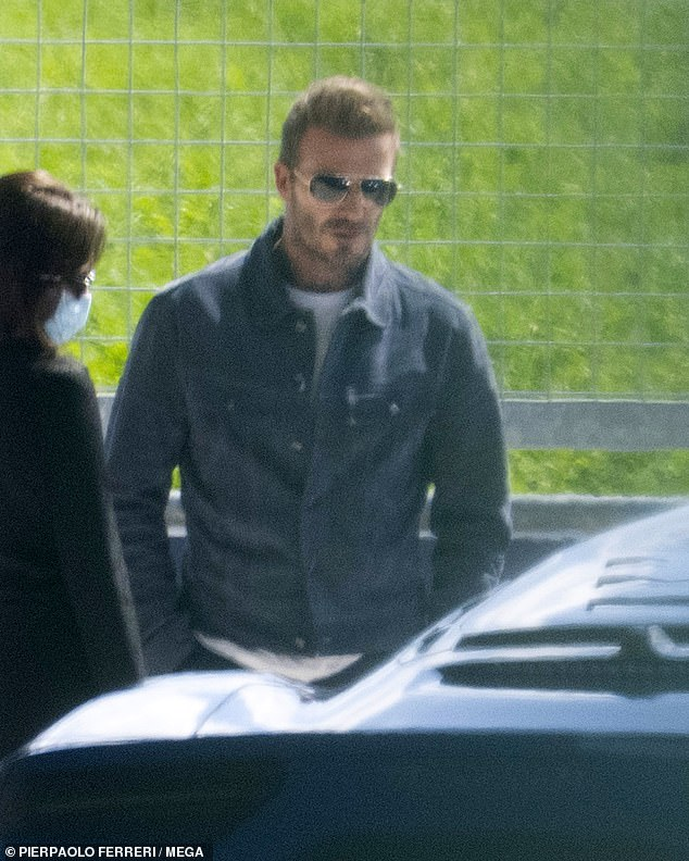 Car fan: David Beckham got to grips with the new blue Maserati MC20 at the Modena autodrome in Italy on Tuesday