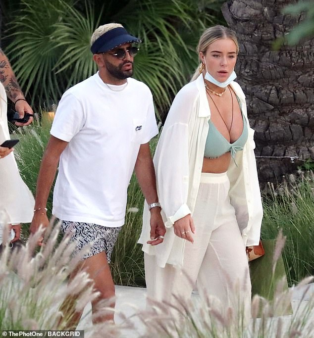 Lovebirds: Newly-engaged Manchester City star Riyad Mahrez hit the beach with his fiancée Taylor Ward in Mykonos on Tuesday