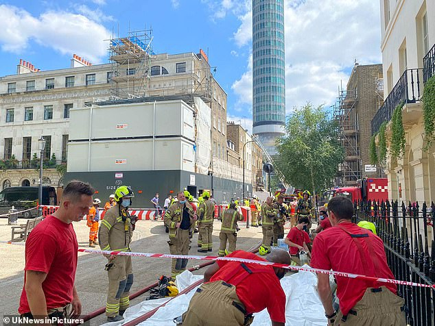 Dozens of firefighters were seen close by to the pub and getting their uniforms on