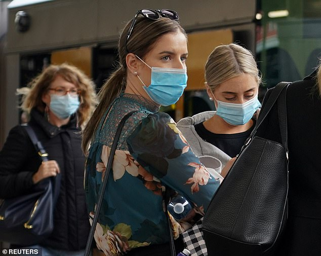 New South Wales has recorded 11 new local cases of Covid-19 overnight. Commuters pictured wearing face masks on a train platform at Central Station on Wednesday