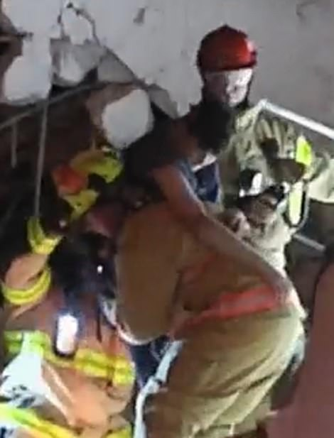 Video from the scene showed firefighters pulling a young boy from the rubble. Witnesses also reported hearing screams from beneath the collapsed building