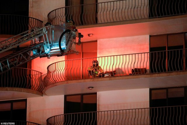 Freelance journalist Joel Franco, who was on the scene, claimed that the fire department had managed to rescue some people from their balconies. Pictured: Emergency personnel working at the scene