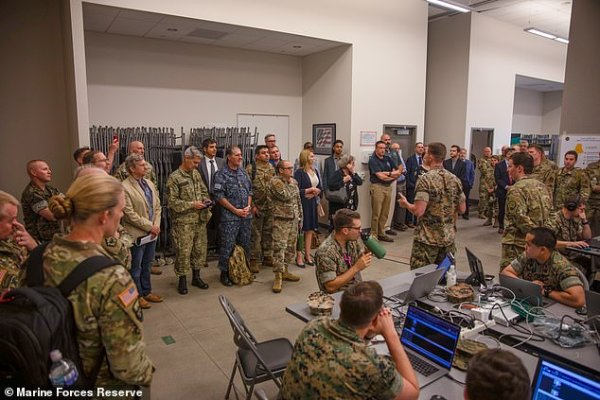 The Marines speak to visitors during Cyber Yankee 21 at Camp Edwards, Massachusetts. The exercise included a huge cyberattack targeting utilities on the west coast before moving east across the country.