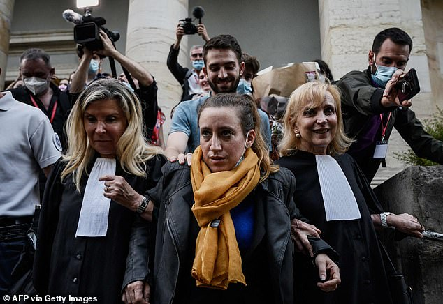 Valérie Bacot, 40, from France, pictured leaving Chalon-sur-Saone Courthouse at the end of her trial on charges of murdering her stepfather turned husband