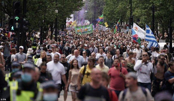Anti-lockdown protesters were seen marching along Oxford Street (pictured) in central London on Saturday as they called for the end to all Covid regulations after Freedom Day was delayed from June 21