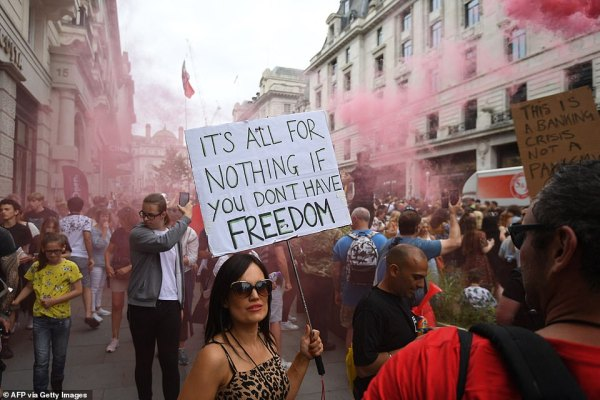 Anti-Vaccine and anti-lockdown protestors march through central London on Saturday brandishing placards which read 'it's all for nothing if you don't have freedom'