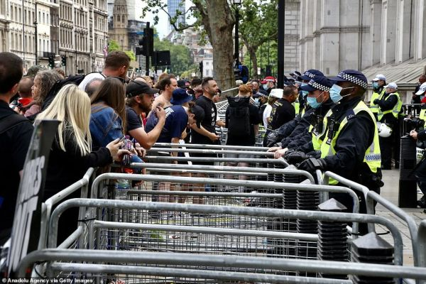 Metal gates separated police and the demonstrators during the protest outside Downing Street earlier this afternoon