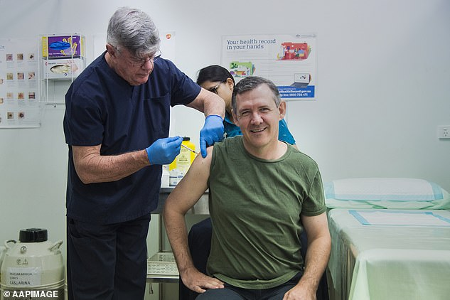 Northern Territory Chief Minister Michael Gunner said 'We'll do everything we can to test, trace and track this virus, will always do whatever it takes to keep you safe'. He is pictured getting the AstraZeneca COVID-19 vaccination at a Darwin GP clinic in March