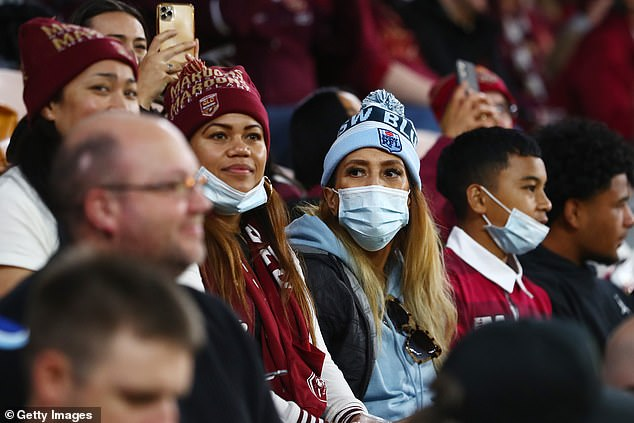 State of Origin went ahead on Sunday night (pictured) and was a resounding victory for NSW - but fans were told to be cautious of the recent outbreaks, with masks mandatory when not sat down