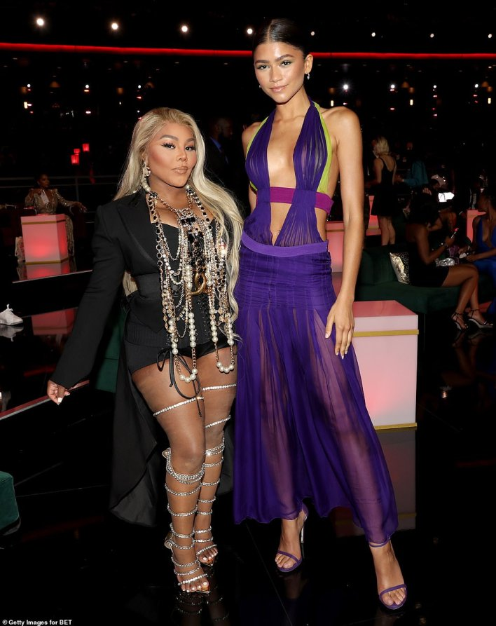 Taking the plunge! Zendaya, posing with Lil' Kim, got heads turning in a plunging purple dress with sheer skirt
