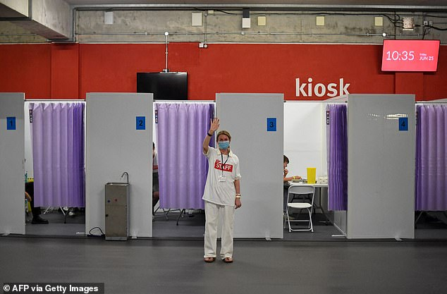 Pictured above is the vaccination centre at the Emirates Stadium, London